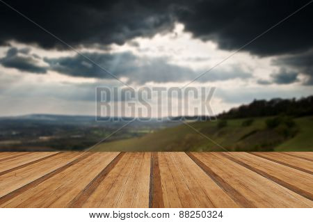 Beautiful Sunset Beams Over Rolling Countryside Landscape With Wooden Planks Floor