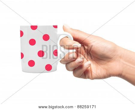 Woman Hand With Polka Dot Cup Of Coffee