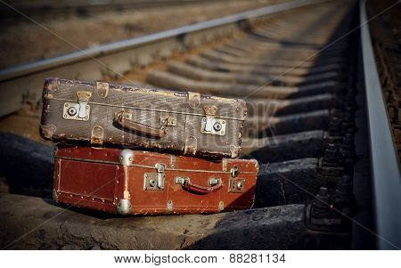 The Image Of Forgotten Suitcases On Railway Tracks.