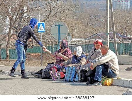 Woman Gives Alms At Easter