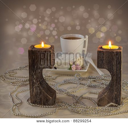 Cup Of Coffee On The Background Candlesticks In The Shape Of Heart