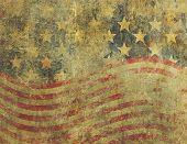 A US American flag design in a grunge style heavily distressed damaged and faded with the appearance of being old paint on concrete. poster