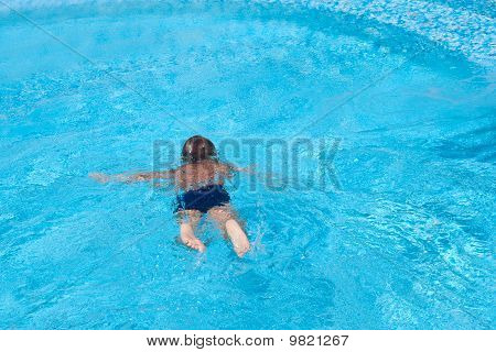 The Child Swims In Pool