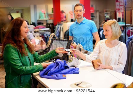 Young Woman And Man In The Clothes Shop