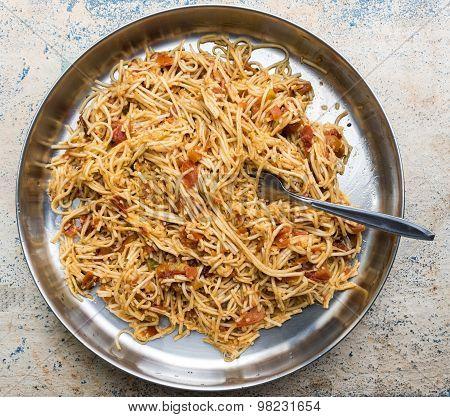 Hakka Noodles kept in plate with fork prepared in Calcutta