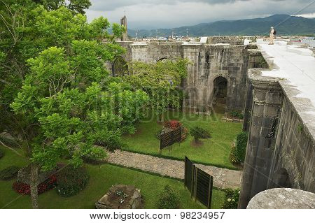 Tourist enjoys the view to the ruins of Santiago Apostol cathedral in Cartago, Costa Rica.