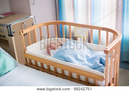 Newborn Baby Boy In Hospital Cot