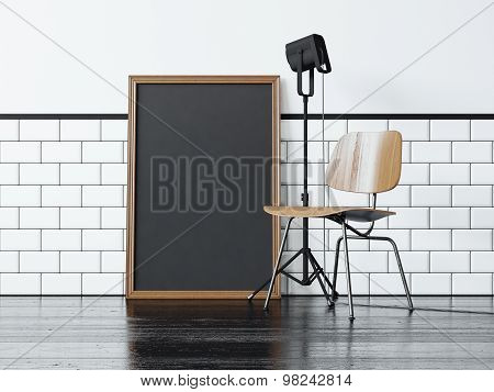 Black poster near the chair. 3d rendering