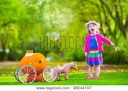Little Girl At Pumpkin Patch At Halloween
