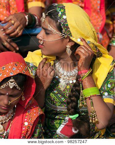PUSHKAR INDIA - NOVEMBER 21: An unidentified girls in colorful ethnic attire attends at the Pushkar fair on November 21 2012 in Pushkar Rajasthan India. poster
