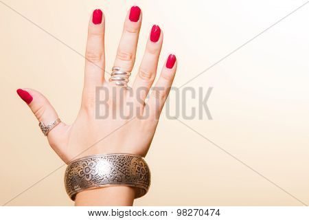 Female Hand With Manicure And Armlet