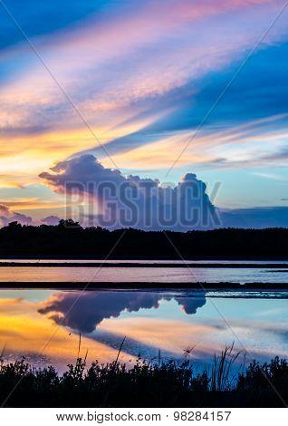 Beauty colorful empty saline on sunset . poster