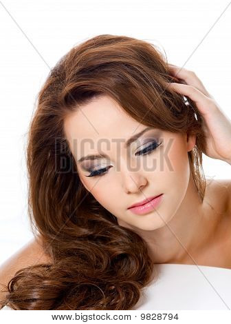 Woman With Beauty Hairs And Glamour Makeup