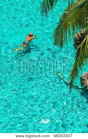 Relaxing in swimming pool.