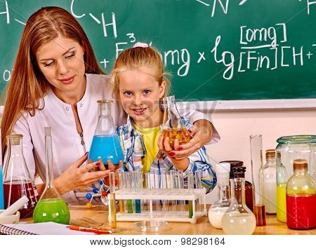 Child and woman holding flask in school class. Chemistry teacher poster