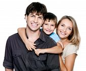 Happy young family with pretty child posing on white background poster