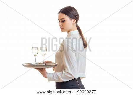 woman waiter with a glass of wine on a tray isolated on white background