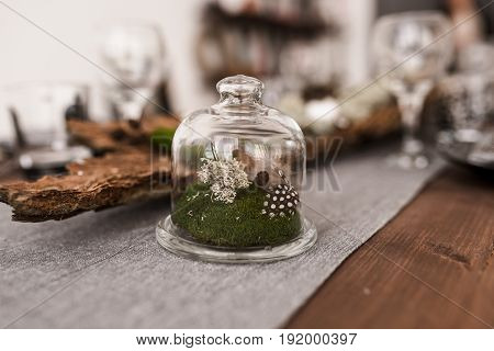 wedding table decorated by plates knives and forks moss greenery