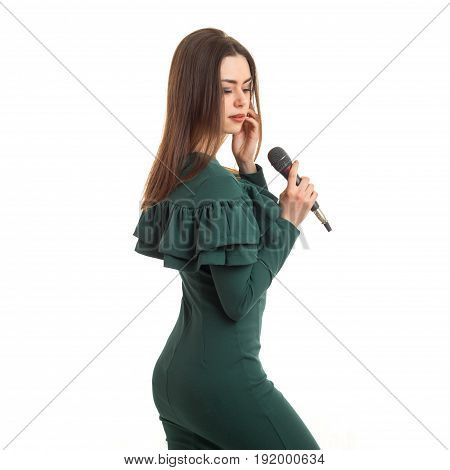 square portrait of girl with a microphone in a green dress isolated on white background