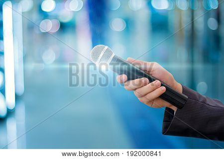 Hand Of A Businessman With A Microphone .