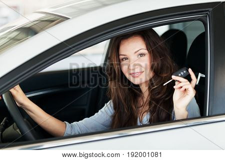 Car woman buying car expensive luxury retail sale