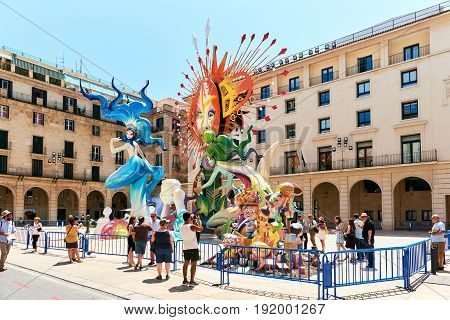 Alicante Spain - June 20 2017: Preparation for The Bonfires of Saint John holiday in the Alicante city. Decorations are structures made of cardboard wood or cork which are exhibited in the streets of Alicante during the festival and are set on fire on the