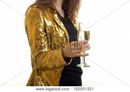 woman in golden jacket holds a glass of wine isolated on white background
