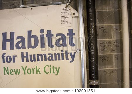 Sign and messages in staging area room of Habitat for Humanity New York City housing unit building project in the Brownsville section of Brooklyn, NEW YORK MAY 25 2017.