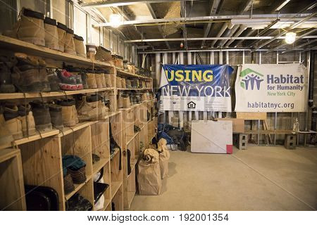 Interior of staging area room of Habitat for Humanity New York City housing unit building project in the Brownsville section of Brooklyn, NEW YORK MAY 25 2017.