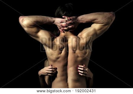 Naked Couple Standing In Studio Back View Making A Hug