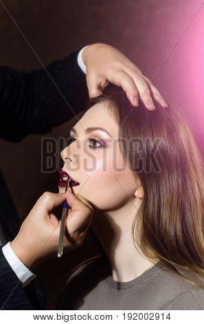 Girl Getting Lips Painted In Beauty Salon