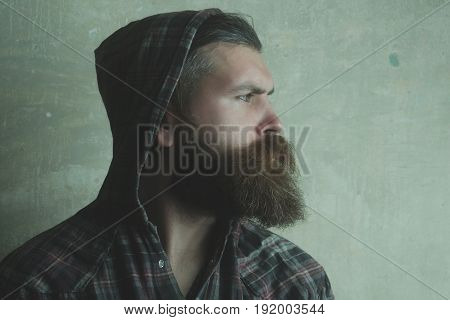 Brutal Man With Long Beard Wearing Hood On Head