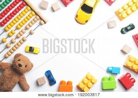 Kids toys frame on white background. Top view. Flat lay. Copy space for text