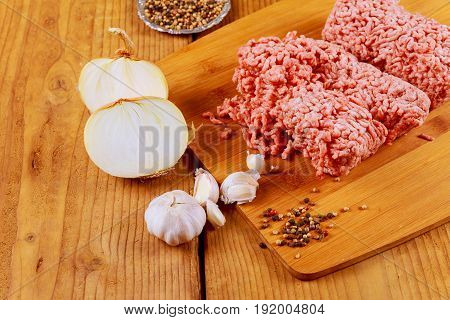 Minced Beef Meat With Basil Leaves Ready For Cooking