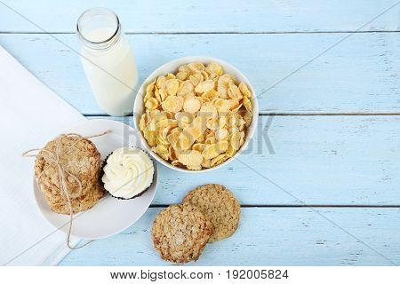 Cornflakes, Bottle Of Milk And Cookies On Wooden Table