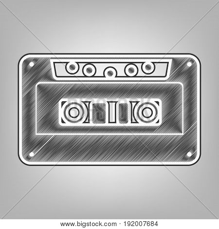 Cassette icon, audio tape sign. Vector. Pencil sketch imitation. Dark gray scribble icon with dark gray outer contour at gray background.
