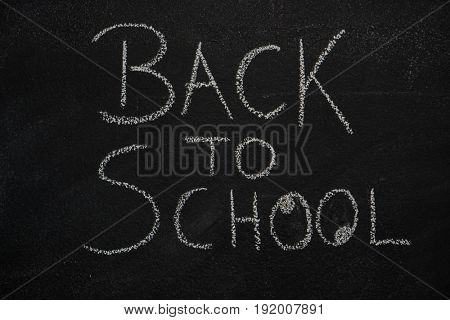 Back to school text written with chalk on blackboard. Education, school concept