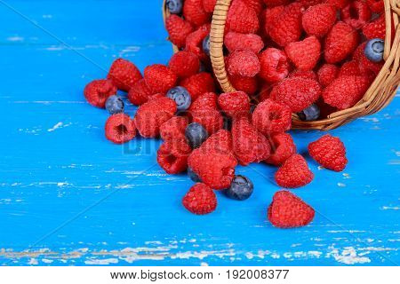 Fresh Berry Fruit Pile Basket With Leaves Placed On Old Wooden Planks