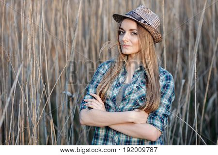 Attractive Young Blonde Woman In Blue Plaid Shirt Straw Hat Enjoying Her Time On Wild Bush Hard Noon