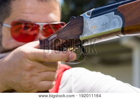 Young man skeet shooting outdoors.  shotgun, skeet, trap