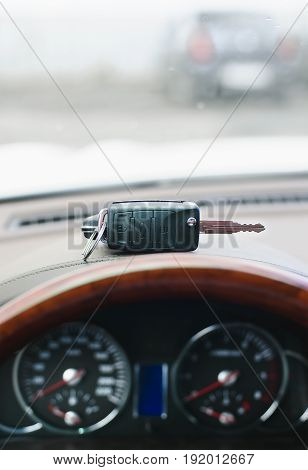 The key of the car lock is located on the dashboard with a shallow depth of field
