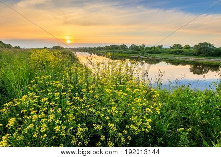 Sunrise Above The River At Summer With Cloudy Sky Background.