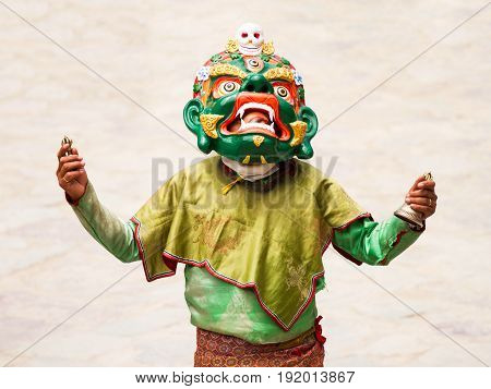 Hemis, India - June 29: Unidentified Monk With Ritual Bell And Vajra Performs A Religious Masked And