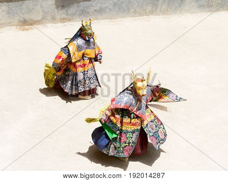 Unidentified Monks In Deer Masks Perform A Religious Masked And Costumed Mystery Dance Of Tibetan Bu