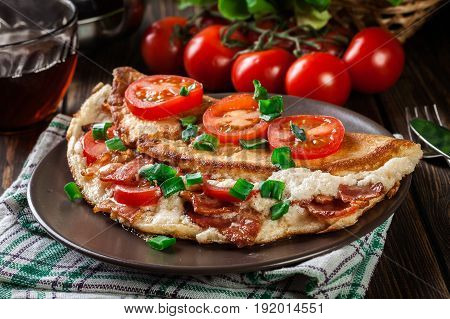 Omelette With Bacon And Tomatoes