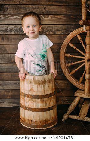Laughing Baby Boy having fun in a wood