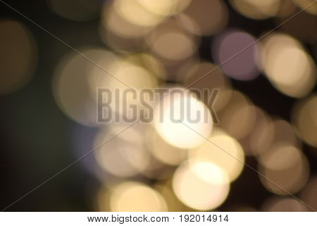 Abstract circular bokeh background of lights,Gold Colored,