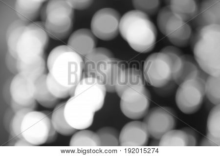 Blured bokeh light in city in black and white tone