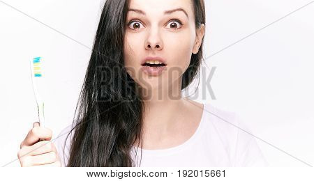 Tooth care, toothbrush, woman with toothbrush, woman on isolated background.