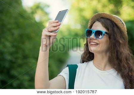 Traveler Using Smartphone Camera To Take Selfie Or Shooting Street